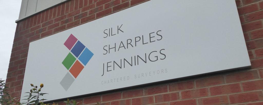 Silk Sharples Jennings Chartered Surveyors sign